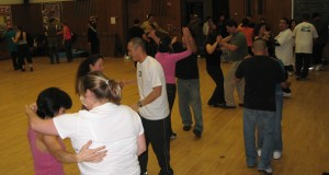 Switching partners salsa dancing at Cañada College.